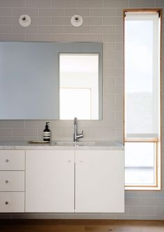 Modern bathroom in white and gray