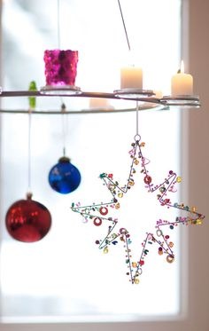 beaded star... @Amy Magi I can only imagine your art jewelry as lovely ornaments or window pretties or dangling charms...