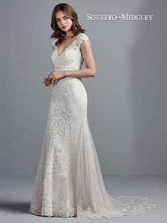 This elegant sheath wedding gown features crosshatched tulle, Swarovski crystals, and beaded lace appliqués accenting the illusion cap-sleeves, illusion back, and illusion petal-shaped train. Complete with V-neckline, and lined with Inessa Jersey for a luxe fit. Finished with covered buttons and zipper closure. Colours Ivory Ivory over Soft Pearl Size UK0 – 28