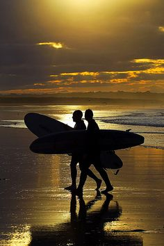 Surfing at Sunset at Belhaven Bay, near Dunbar, Scotland