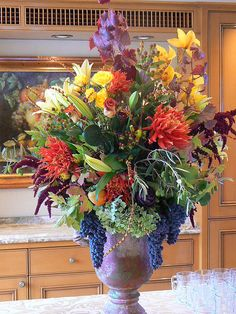 Fall urn arrangement with wine grapes by christineinca, via Flickr