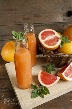 Pic: Natural and fresh grapefruit juice in small bottles