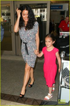 Salma Hayek arrives on a flight at LAX Airport with her daughter Valentina on July 1, 2013