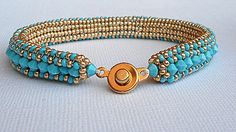 A beautiful gold and turquoise beadwork bracelet that will add a touch of class to any outfit. It is herringbone stitch with swarovski turquoise crystals. Wear it with a pair of jeans or a cute dress. It will never go out of style. Fits an average 7 1/2 wrist. 3/4 wide. Gold snap clasp. Treat yourself