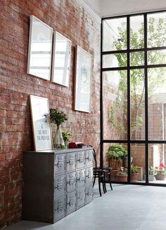 windows to die for ... brick slip wall... warm but modern