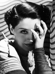 Norma Shearer, 1930s, photo by George Hurrell. She's wearing the marquise-cut diamond engagement ring given her by Irving Thalberg.