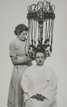 """Getting a """"permanent wave"""" with the new Gallia machine, 1935"""