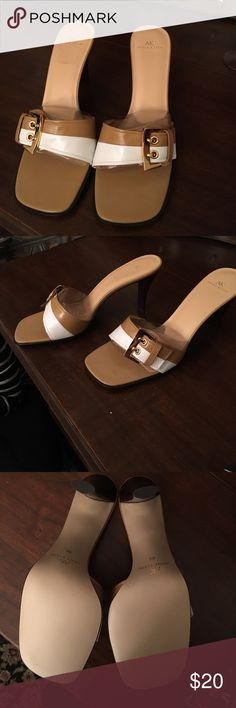 Anne Klein tan and white slip on sandals! Anne Klein tan and white slip on sandals! Really cute and perfect for the summer party!!! Brand new and great condition!! Anne Klein Shoes Sandals