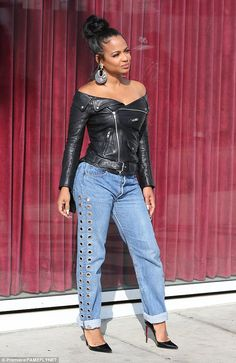 It's not Halloween yet: Christina Milian was spotted in Hollywood on Thursday in a bizarre off-the-shoulder leather jacket and jeans that featured holes down each leg
