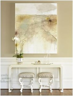 Love the large wall art on taupe walls
