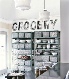 No space for a pantry? No problem! Just outfit a utilitarian shelving system with breathable baskets that can corral everything from various types of produce to bulky bags of dry goods like flour and sugar. For even more versatility, try a wire basket storage cart equipped with casters, which make it possible to roll it out of sight when not in use.   - CountryLiving.com