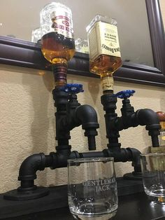 Stainless Steel Double Liquor Dispenser. All the fittings are made of Lead free fittings, Only Stainless Steel & Brass fittings/valves used ***NO black steel (will rust) All are painted with a Flex Seal style paint -Made to order to your desired base wood finish: natural weathered gray, black or weathered white -Top is size is 1 inch- will accept any 750ml bottle that accepts a pourer spout. All wood is reclaimed wood Note: all parts are cleaned & sterilized **Measurements L-20 W...