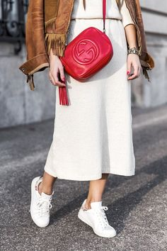 suede fringe jacket, red Gucci bag, midi skirt and sneakers