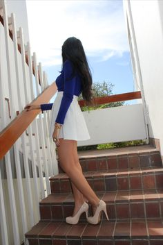 royal blue top white skirt nude high heels