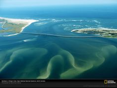 Swirling sandbars can be seen from the air Oregon Inlet Cape Hatteras National Seashore Outer Banks North Carolina Outer Banks North Carolina, South Carolina, Outer Banks Nc, Carolina Beach, South Pacific, Oh The Places You'll Go, Places To Travel, Places To Visit, Chapel Hill