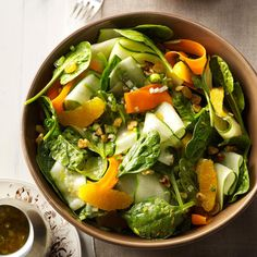 """Ribbon Salad with Orange Vinaigrette Recipe -Zucchini, cucumbers and carrots are peeled into """"ribbons"""" for this citrusy salad. We like to serve it for parties and special occasions. —Nancy Heishman, Las Vegas, NV"""