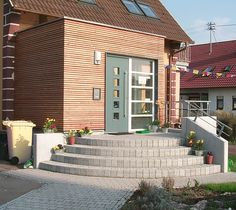 Umbau,Anbau,Erweiterung,Windfang,Holzbau,Außentreppe,Einfamilienhaus