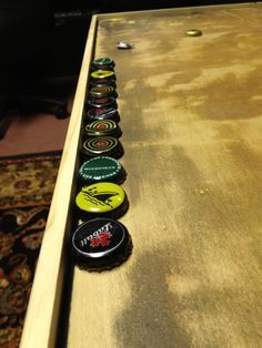 Beer Cap Table tutorial – Tea & Beer After just over a year of saving bottle caps the table is complete! Step FInd a cheap table. Step Make sure the table is clean and ready to go. the particular table I started with was a ve… Beer Cap Art, Beer Bottle Caps, Bottle Cap Art, Beer Caps, Beer Bottles, Beer Cap Crafts, Craft Beer, Diy Bottle Cap Crafts, Bud Light