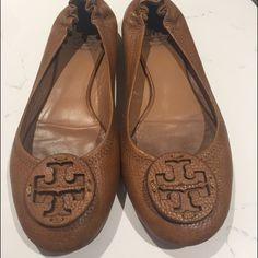 Size 8 Tory Burch reva flat A must have for every closet! Tory Burch reva's size 8 only worn a few times. 100% authentic. Purchased from Nordstrom. Perfect color to go with everything. Tory Burch Shoes Flats & Loafers