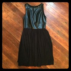 Bailey44 black leather dress Perfect blend of edgy and feminine! The leather is super soft. Fitted in bust with soft jersey cotton skirt. Very comfortable and easy to wear- cute with tights and booties. Excellent condition. Hits a little above knee (I'm 5'7). Fits size 0-4, depending on bust size. Bailey 44 Dresses