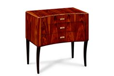 The Tribeca End Table is a rosewood veneered stylish Art Deco inspired chest or bedside chest. Featuring three ample drawers with gently curved fronts, each has a brass rectangular handle. With its hand rubbed high gloss finish, the Tribeca sits on delicately curved ebonized legs. - For more information about this product, please email info@bespokebylg.com