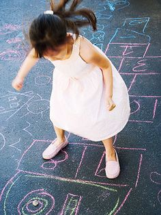 Hopscotch  Get out the colored chalk and help your children draw a huge hopscotch path. Add extra fun by trading traditional hopscotch square shapes for cars, butterflies, fish, and other fun designs.