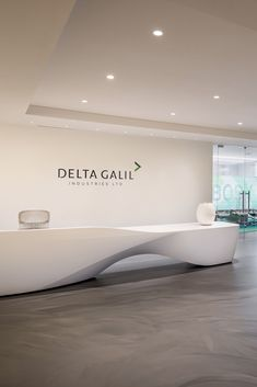 The organic curves of the Kin reception desk compliment the minimalist design of. - The organic curves of the Kin reception desk compliment the minimalist design of… # - Curved Reception Desk, Reception Desk Design, Reception Areas, Office Reception, Dental Office Design, Modern Office Design, Healthcare Design, Modern Offices, Office Designs