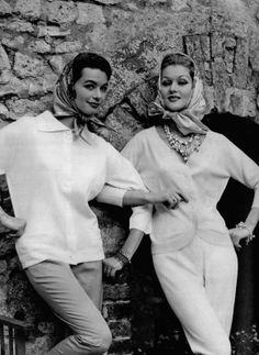 Models in cardigans, left, white wool 3/4 sleeves and right v-neck in pale rose wool both by Timwear, scarves by Léonard, photo by Georges Saad, 1959