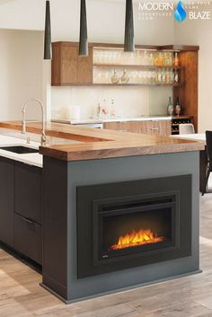 "Install an electric fireplace into your kitchen island - Easily done with Napoleon 24"" Built-in Electric Firebox!"