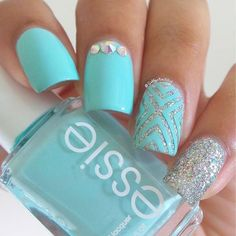 Sky blue and silver glitter spring nail art design. There's nothing more spring inspired look than the brightly colored polish similar as the sky. The silver glitter polish also adds sparkle to the design.