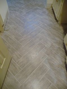 Love this wood look tile and the random pattern its laid in