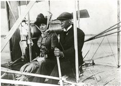Wilbur Wright and Edith (Mrs. Hart O.) Berg seated in an Wright  Aircraft. Mrs. Berg became Wilbur's first woman passenger when they flew  for two minutes at Auvours, France on October 7, 1908. Note Mrs. Berg's skirt tied with cord below the knees.