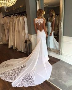 This backless wedding dress has a long train with sheer beaded lace insets. We can make custom #weddingdresses like this in a price range that works for you. Our US dress design firm also specializes in making #replicas of haute couture #weddingdresses. So if what you want is more than you want to spend email us a picture to see how much an inspired version will cost. DariusCordell.com