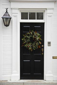 classic entry | black door, white trim, transom, lantern