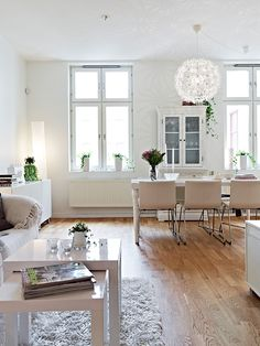 White living and dining by Stadshem.