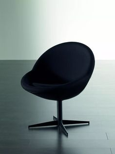 Jo is a retro inspired swivel armchair by Meridiani available in a range of fabrics.