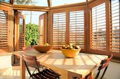 Conservatory shutters in natural wood by Shutterly Fabulous