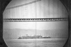 Alcatraz Island framed by the Golden Gate Bridge as seen through the periscope of the US Navy submarine, USS Catfish, in San Francisco Bay 1951.