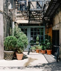 Manhattan neighborhoods: Lower East Side real estate, parks, attractions, events, and lifestyle. Manhattan Neighborhoods, Nyc Real Estate, Lower East Side, Townhouse, Parks, The Neighbourhood, Blues, Events, Lifestyle