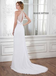 Elegant chiffon sheath wedding dress with plunging neckline and Empire waist, accented with Swarovski crystals. Isla by Maggie Sottero.