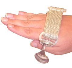 Universal Cuff: Piece of adaptive equipment used to aide in holding objects when grasp is weak.