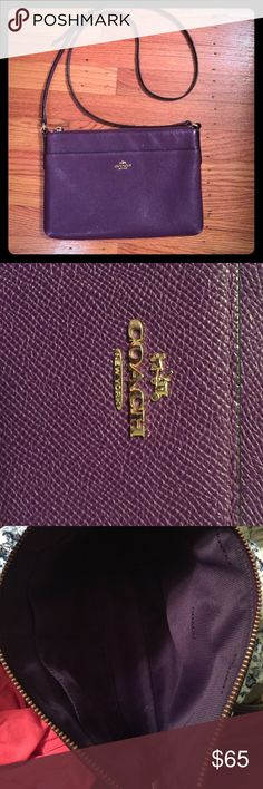 Coach purple crossbody bag Purple crossbody bag by Coach. Perfect for all seasons! There is a tiny bit of wear on the bottom (see picture) but it's barely noticeable. Coach Bags Crossbody Bags