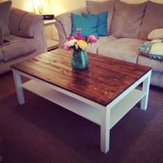 This is a cool Ikea hack: buy one of the plain, cheap Lack coffee tables and secure stained cedar planks to the top.