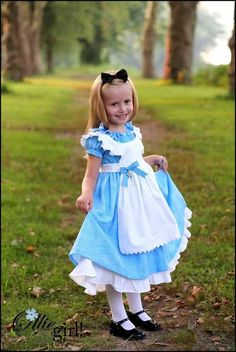 ALICE in WOnderland... aww what more inspiration does anyone need to sew than a smile like that