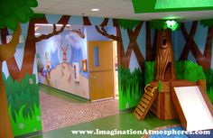 Kid's hallway/pediatric office theme with tree & slide. ©2014 Imagination Atmospheres www.imaginationatmospheres.com