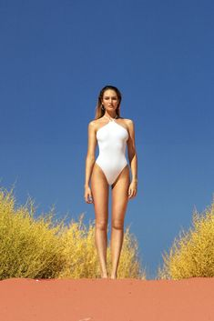 b807924fdc19 a high-neck one piece in a rib fabric with string straps that cross at