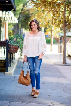 For a casual spring date night look, I wore the Joie Bellange Lace Peasant Top with AG Raw Hem Ankle Legging Jeans and Marc Fisher Adalyn Espadrilles
