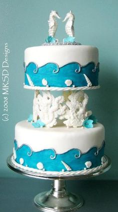 Seahorse wedding cake ... Wedding guide for brides & grooms, bridesmaids & groomsmen, parents & planners ... the how, when, where & why of wedding planning ... https://itunes.apple.com/us/app/the-gold-wedding-planner/id498112599?ls=1=8  ♥ The Gold Wedding Planner iPhone App ♥