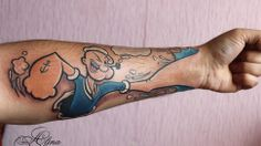 Now that's an exceptionally clever Popeye tattoo