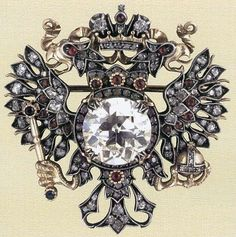 БРОШЬ В ВИДЕ ИМПЕРАТОРСКОГО ОРЛА.                                                            Золото, платина, бриллианты, рубины, алмазы                                                 Фирма К. Фаберже. Россия, Москва, 1913. В оригинальном футляре. (597x600, 137Kb)